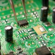 Stock Photo: Assembling a circuit board