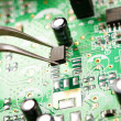 :Assembling a circuit board — Stock Photo