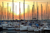 Docked yachts at sunset background — Stock Photo