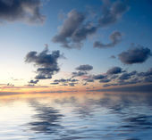 Dramatic sky over water — Stock Photo