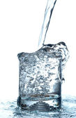 Water jet in glass — Stock Photo