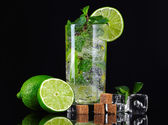 Mojito cocktail over black background — Stock Photo