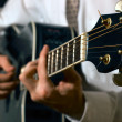 Musician playing guitar — Stock Photo #19571417