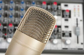 Studio microphone on the audio control console background — Stock Photo
