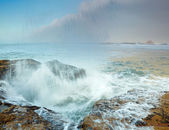 Stormy ocean and crashing waves on rocks — Stock Photo