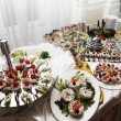 Catering table full of appetizing foods — Stock Photo