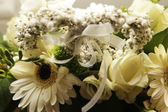 Bouquet in a basket — Stock Photo