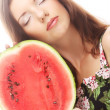 Beauty woman holding watermelon in her hand — Stock Photo