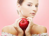 Attractive young woman with an apple — Stock Photo