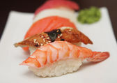 Sushi on a white plate. — Stock Photo