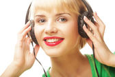 Beautiful woman listen to the music — Stock Photo
