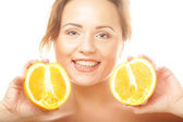 Beautiful woman's face with juicy orange — Stock Photo