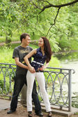 Cute couple in park — Stock Photo