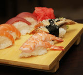 Sushi served on wooden board — Stock Photo