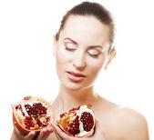 Woman showing pomegranate — Stock Photo