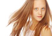Smiling little girl on white background in studio — Stock Photo