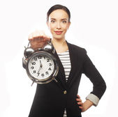 Serious woman with alarm clock isolated on white. — Stock Photo