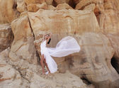 Attractive woman in the desert — Stock Photo
