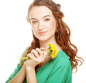 Woman with dandelion bouquet — Stock Photo