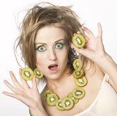 Happy woman holding kiwi — Stock Photo