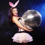 Sexy bunny-girl with disco ball — Stock Photo