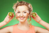 Beautiful woman`s face with kiwi — Stok fotoğraf