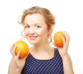 Blond woman with oranges — Stock Photo