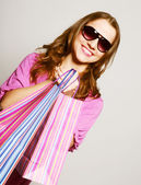 Woman in sunglasses on shopping — Stock Photo