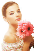 Beautiful young woman with gerber flowers — Stock Photo