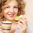 Womwith coffee and cookies — Stock Photo #27715261