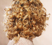 Beautiful female curly blond hairs - back view — Stock Photo