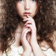 Image of beautiful young womwith curly hair — Stock Photo #27753617