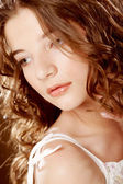 Image of beautiful young woman with curly hair — Stock Photo