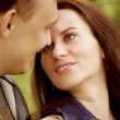 Closeup portrait of smiling young couple in love — Stock Photo #27775623