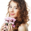 Stock Photo: Blond girl with pink flower on white background