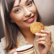 Womwith coffee and cookies — Stock Photo #27776115