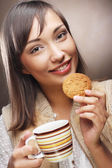 Woman with coffee and cookies — Stock Photo