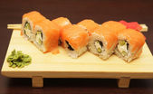 Japanese sushi served on wooden board — Stock Photo