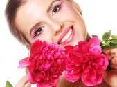 Young beautiful woman with pink peony — Stock Photo