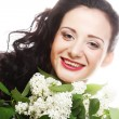Woman with white flowers — Stock fotografie