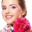 Young beautiful woman with pink peony — Stock Photo #28164267