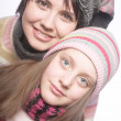 Stock Photo: Beautiful mother daughter winter portrait