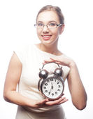 Businesswoman wearing glasses holding alarm clock — Stock Photo