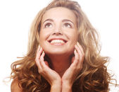 Closeup of a happy young woman looking up — Stock Photo