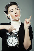 The business woman with an alarm clock — ストック写真