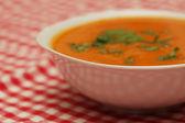 Closeup of a bowl with pumpkin soup — Stock Photo