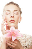 Blond girl with pink flower on white background — Stock Photo