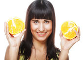 Woman with oranges in her hands — Stock Photo
