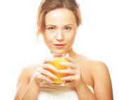 Woman isolated shot drinking orange juice — Stock Photo