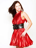 Woman in red dress with long dark hair — Stock Photo